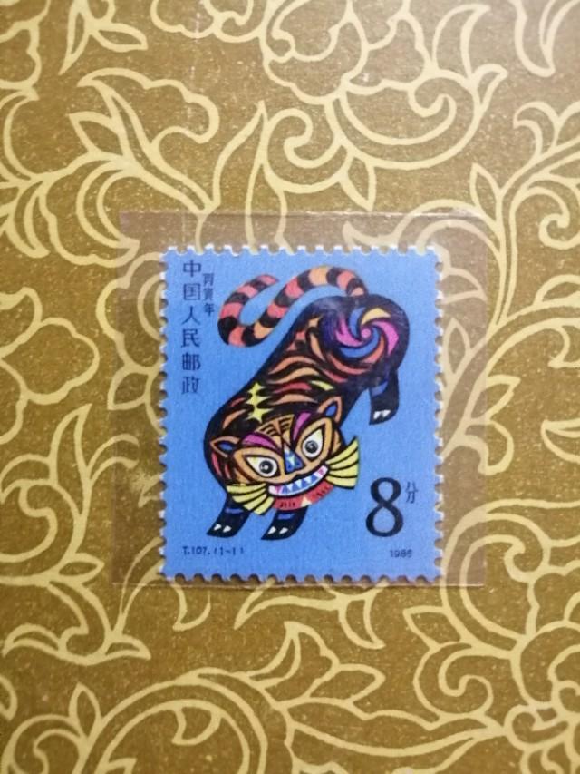 超可爱老虎图片,86年虎邮票值多少钱一张?
